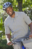 African American Man Riding Bike Royalty Free Stock Photo