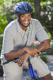 African American Man Riding Bike Stock Image
