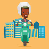 African-american man riding scooter in the city. Royalty Free Stock Photos