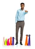 African american man with shopping bags and holding credit card Royalty Free Stock Image