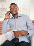 African american man sitting on the chair Royalty Free Stock Image