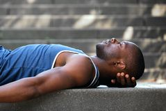 African american man sleeping outside Stock Photo