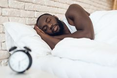 African American man sleeps in bed royalty free stock photo