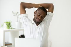 Free African American Man Stretching Doing Office Exercises At Sedent Royalty Free Stock Image - 109505466
