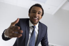 African American man stretching hand Stock Photo