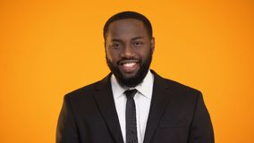African-american man in suit smiling and looking to camera, sales representative. Stock footage stock footage