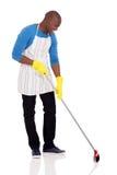 African american man sweeping stock image