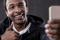 African American man taking selfie Stock Photo