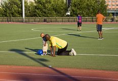 Free African American Man, Teaches Boy To Kick Soccer Ball Yankee Stadium Track Bronx NY Stock Image - 153502731