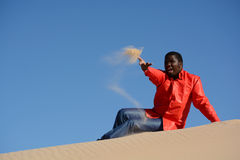 African American man throwing sand royalty free stock photo