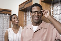 An African American Man Trying On Glasses Stock Image