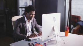 African american man type on keyboard in the modern office. African american serious man working at office stock footage