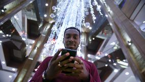African American Man using business app on smart phone stock video