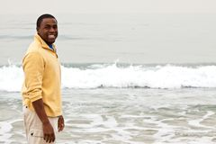 Free African American Man Walking On The Beach. Stock Images - 117923974