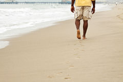 Free African American Man Walking On The Beach. Royalty Free Stock Photo - 93663565