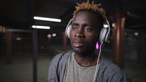 African american man wearing headphone at night underground tunnel stock footage