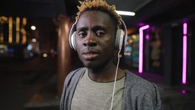 African american man wearing headphone at night underground tunnel stock video footage
