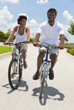 African American Man & Woman Couple Cycling Stock Images