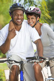 African American Man & Woman Couple Cycling Stock Image