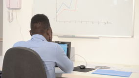 African American Manager working. At a computer. businessman tired and upset, crumples the sheet stock footage
