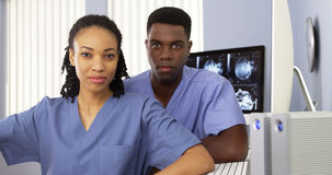 African American medical specialists sitting in front of computer Royalty Free Stock Images