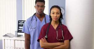 African American medical specialists standing in hospital Stock Images