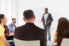 African-american man doing presentation in office. African-american men doing presentation in office, copy space. Startup business meeting, sharing new ideas to stock image