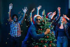 African american man hugging with cristmas tree Stock Images