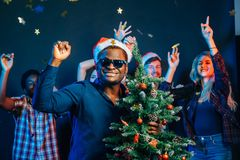 African american man hugging with cristmas tree Royalty Free Stock Images