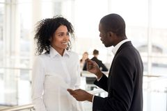 African american mentor ceo explaining helping mixed-race intern royalty free stock photography