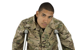 African American Military Man on Crutches. A wounded service man looks depressed Royalty Free Stock Photos