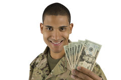 African American Military Man with Money. A happy soldier holds money in his hands royalty free stock images