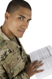 African American Military Man with textbook. A high angle shot of a serviceman with a book royalty free stock photo