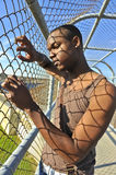 African American model behind a fence. African American model and dancer in Richmond Virginia Royalty Free Stock Photos