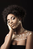 African American model in gold Stock Photography
