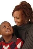 African american mother and so. N looking at each other against white background Stock Photos