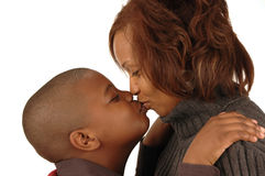African american mother and so. N kissing against white background Royalty Free Stock Image