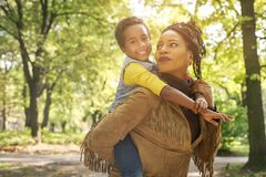 African American mother with daughter in park. stock photo