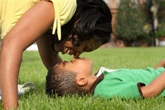 African American  Mother and Child. Happy smiling African American mother and child in park Stock Image