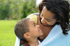 African American  Mother and Child. Happy smiling African American mother and child in park Royalty Free Stock Photo