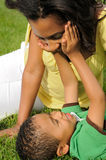African American Mother and Child. Happy smiling African American mother and child in park Royalty Free Stock Image