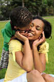 African American Mother and Child. Happy smiling African American mother and child in park Royalty Free Stock Photos