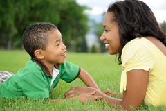 African American Mother and Child. Happy smiling African American mother and child in park Stock Photos