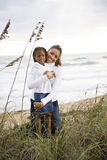 African-American mother and daughter at beach Stock Photo