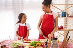 African American mother and daughter preparing stock images