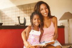 African american mother and daughter studying Stock Image
