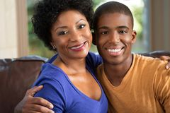 Mother hugging her adult son. Royalty Free Stock Photography