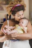 African american mother hugging her baby Royalty Free Stock Images