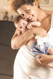 African american mother hugging her baby Stock Images