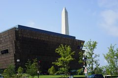 African American museum and Washington monument. The National Museum of African American History and Culture NMAAHC is a Smithsonian Institution museum designed Stock Photography